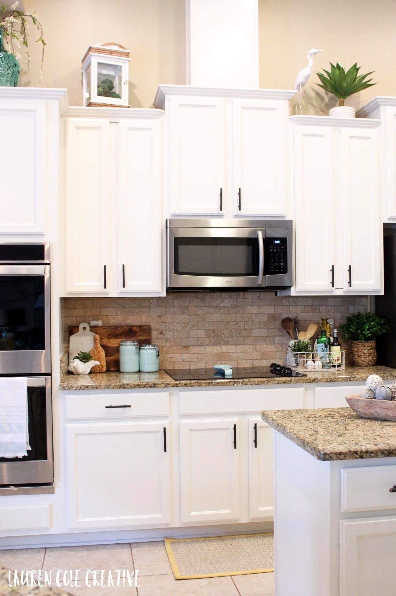 Coastal Kitchen Cabinets #swisscoffeebenjaminmoore Painted Cabinets in OC-45 Swiss Coffee Benjamin Moore.  All the perfect prep work and this gorgeous neutral white without too much undertone makes this kitchen a coastal dream. #swisscoffeebenjaminmoore