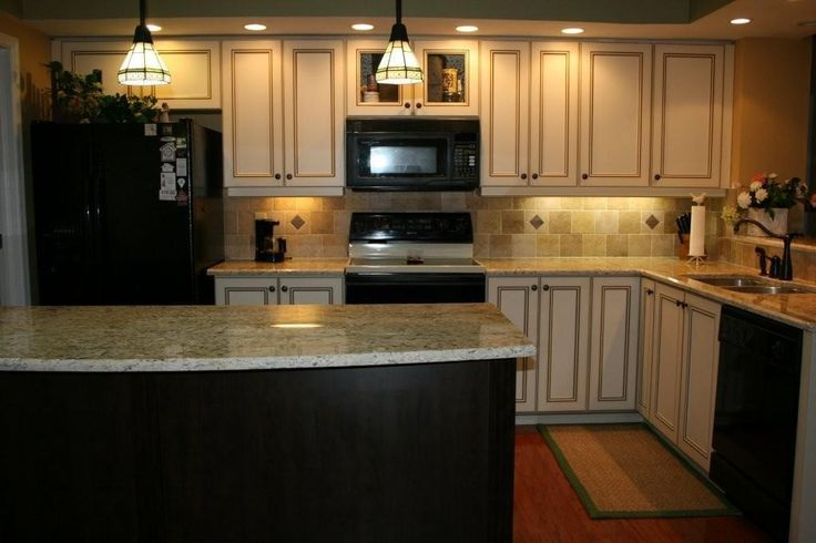 Image result for cream kitchen cabinets backsplash for Brown kitchen cabinets with black appliances