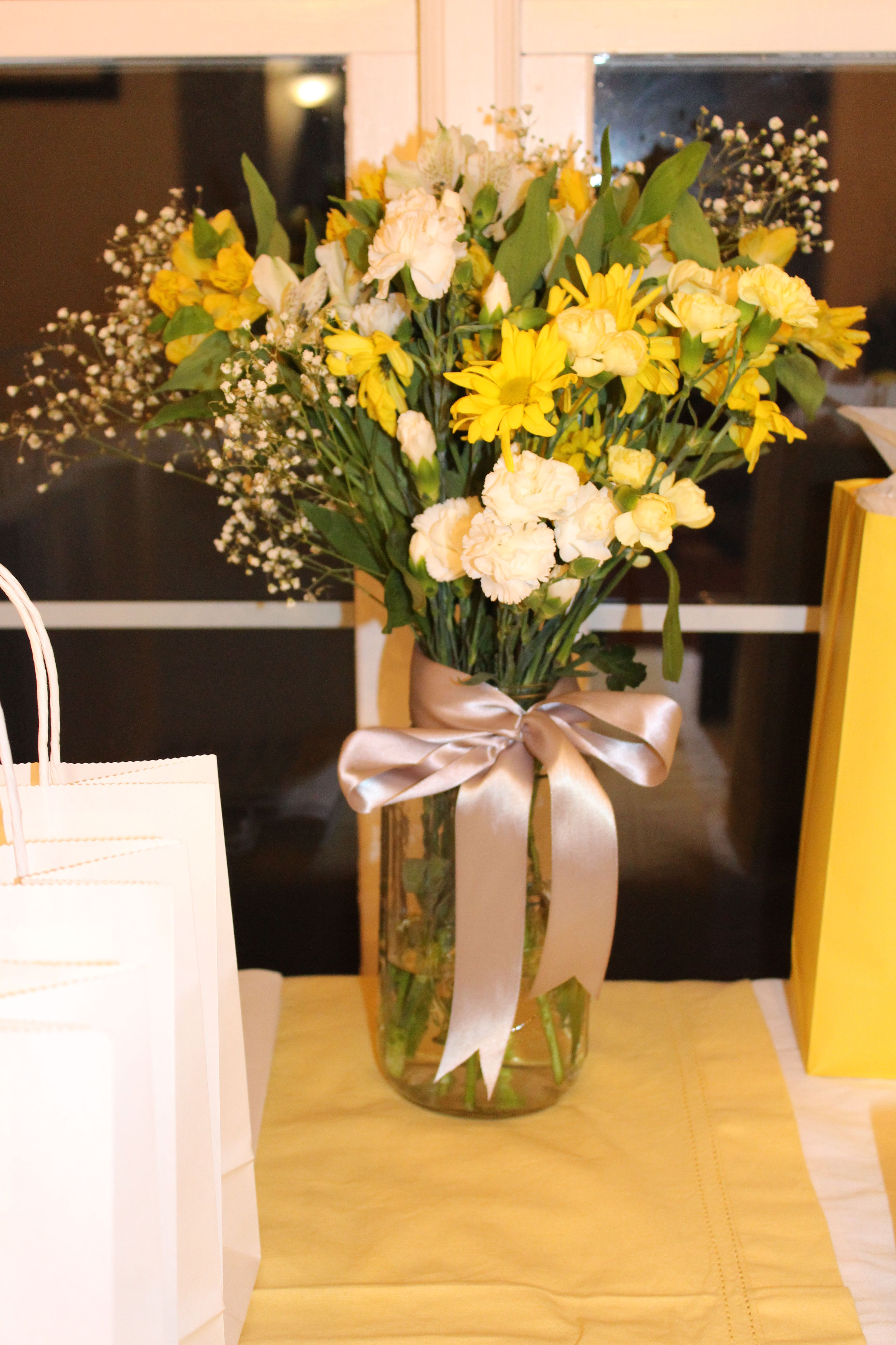 Yellow And White Flower Centerpieces In Mason Jars