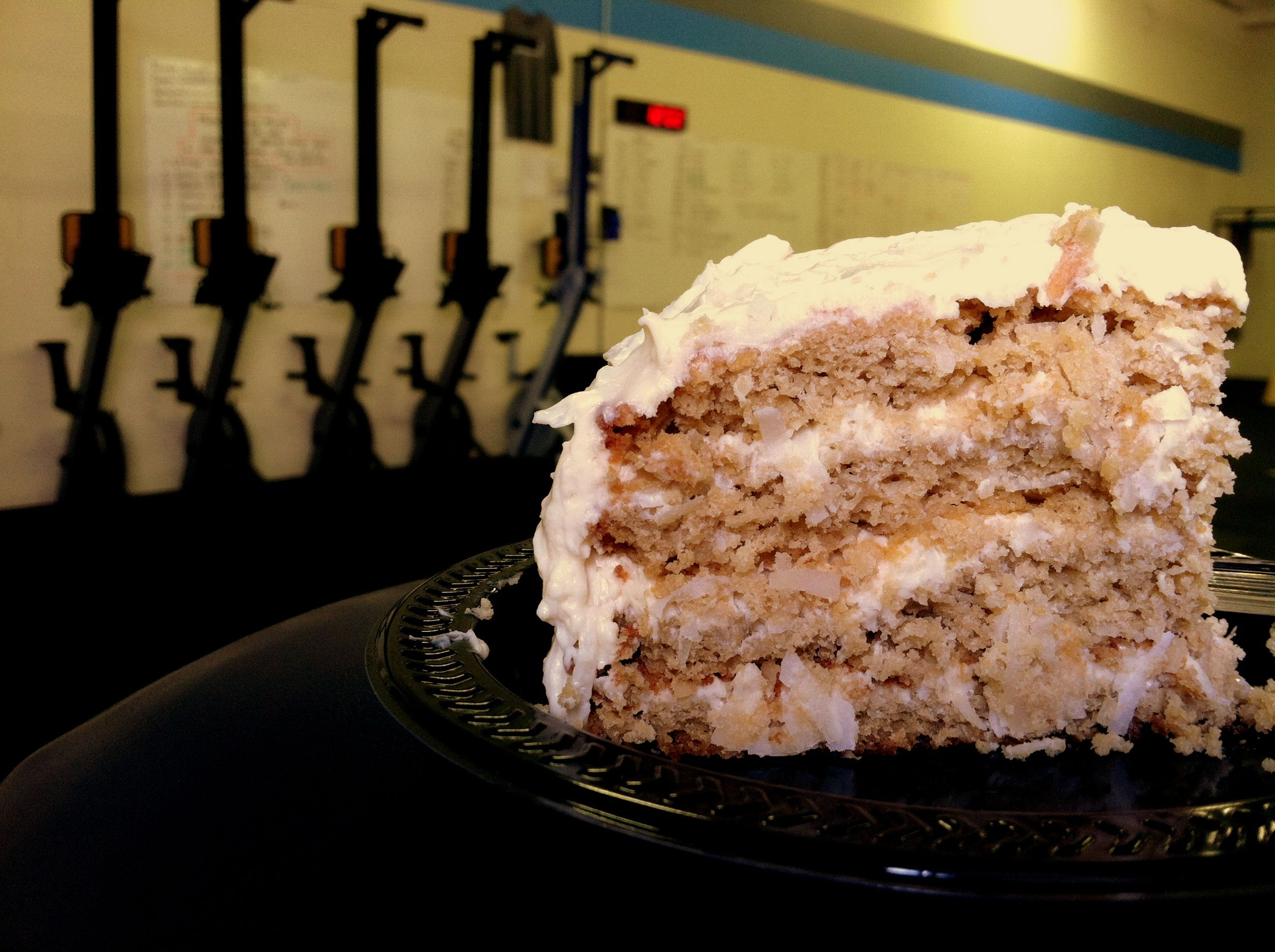 Primal coconut layer cake with coconut cream cheese frosting