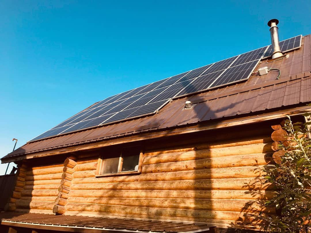 Finally A Clear Day In Inuvik The Team Are Powering On And Have Completed This 7 6kw System For This Delightful Log Solar Solutions Log Homes Roof Solar Panel