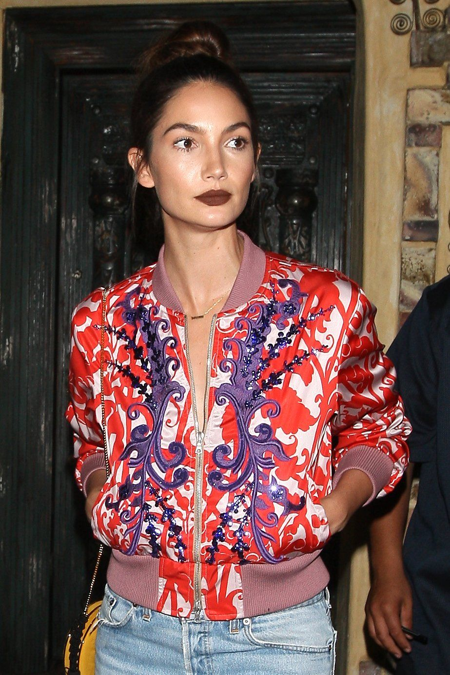 0e314d239c2 Lily Aldridge pairs a neatly painted matte chocolate lip with a swirl of  bronzer and an easy topknot.