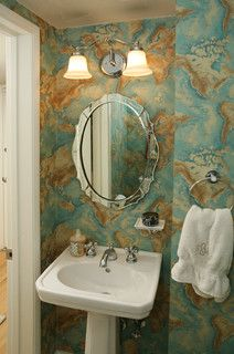 Pedestal sink; two lights over vanity; soap dish on wall; bold paper