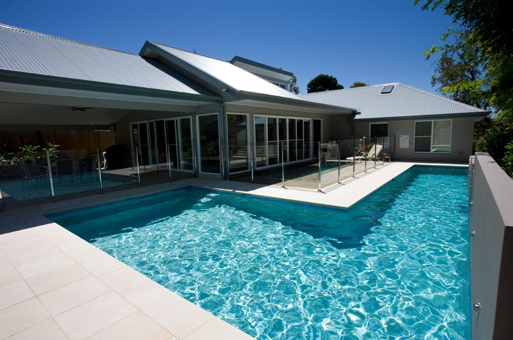 This beautiful wrap around pool has been designed not only