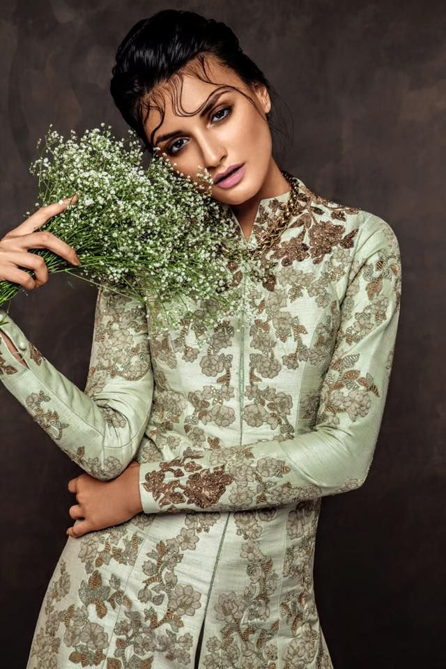 A pale green jacket with romantic florals done in antique zardosi and threads.