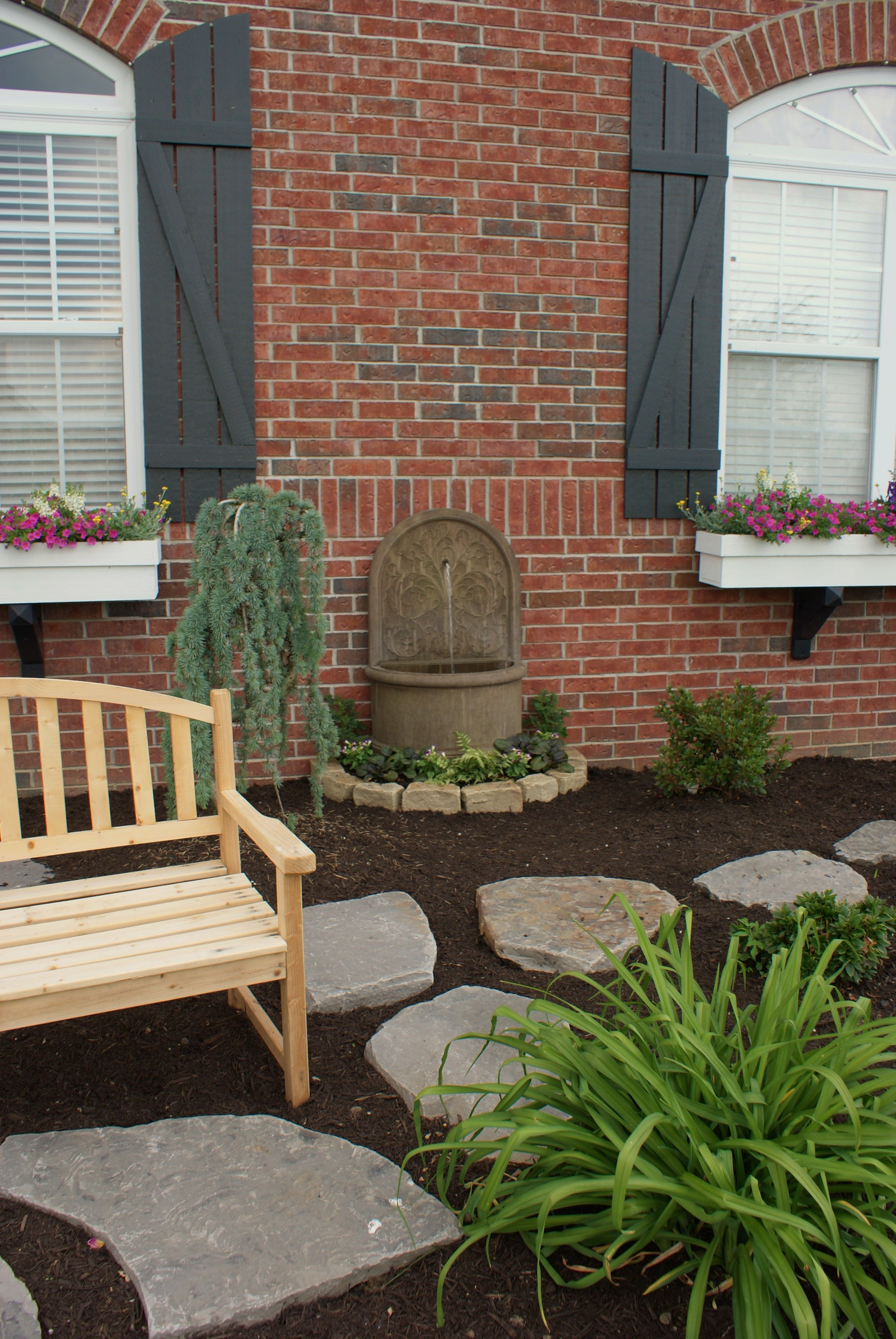 Front bed pathway. A park bench is great for watching kids as they ...