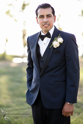 fcfb8253ed26e Diamond bar wedding groom navy blue tuxedo with black lapel and matching vest  with white dress shirt and black bow tie with jacket and white boutonniere