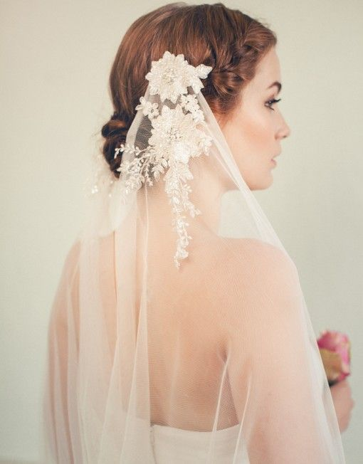 The dreamiest tulle veil adorned with exquisite french lace