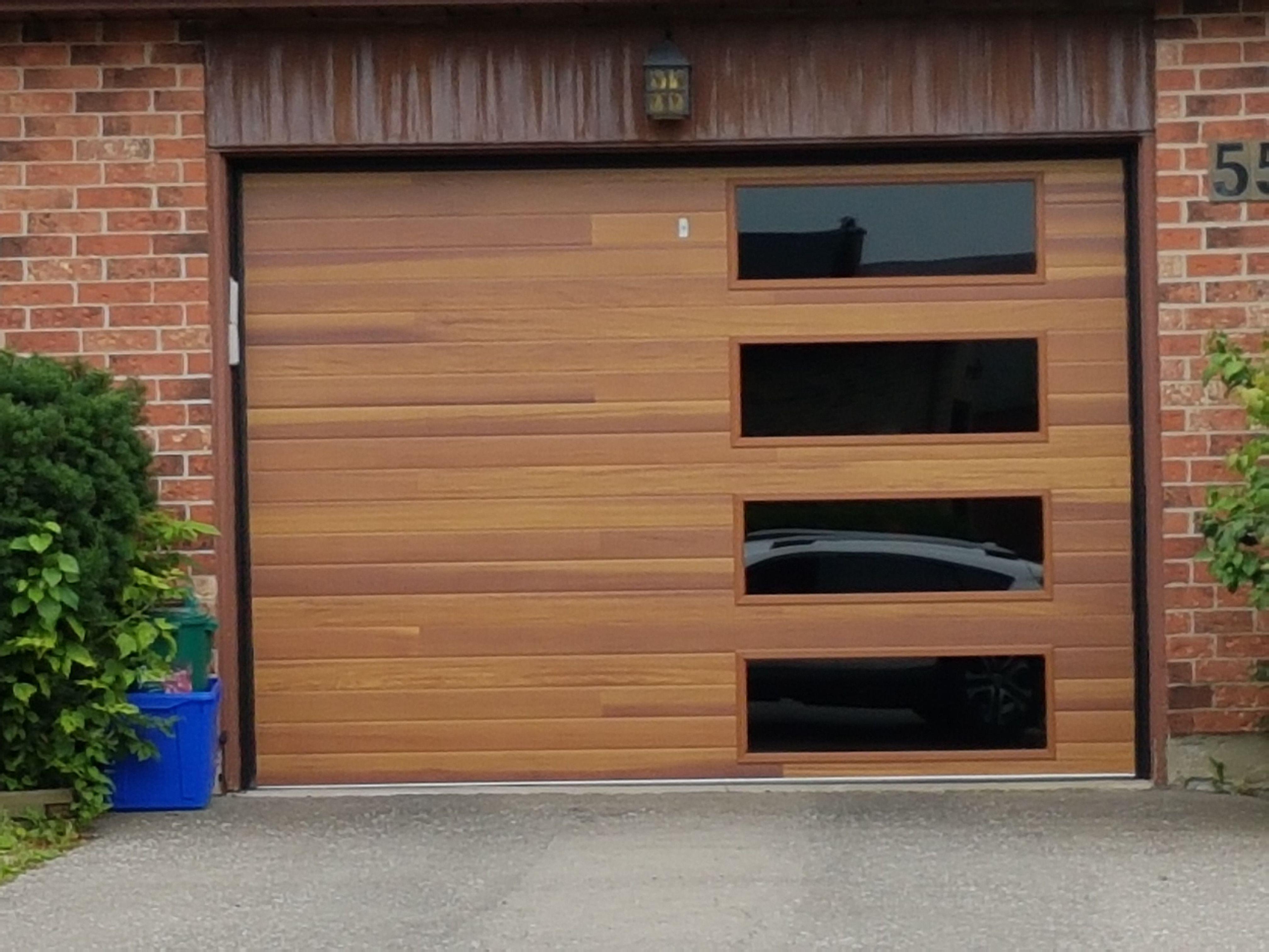 Who Says A Steel Door Can T Look Like Wood This Beautiful Dodds Platinum Series Contemporary Door I Garage Door Styles Brick Exterior House Garage Door Design