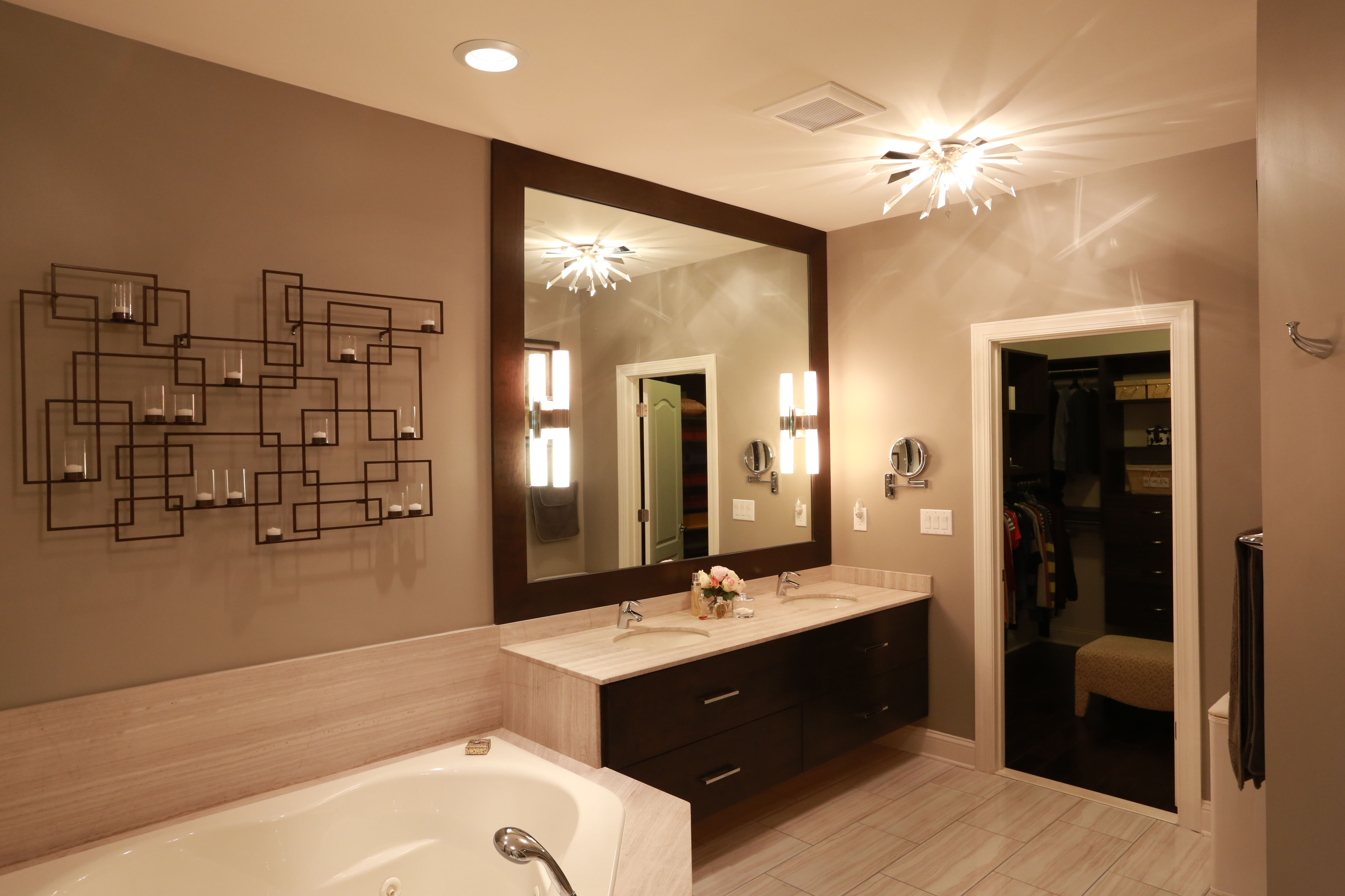 Master bathroom with a fashionable wall candle holder in ...