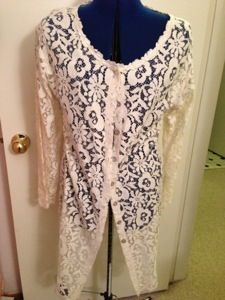 Refashion: Old to new lace coat into a cute modern toddler tee.  http://refashionmama.wordpress.com/2012/11/16/refashion-old-to-new-lace-tee/