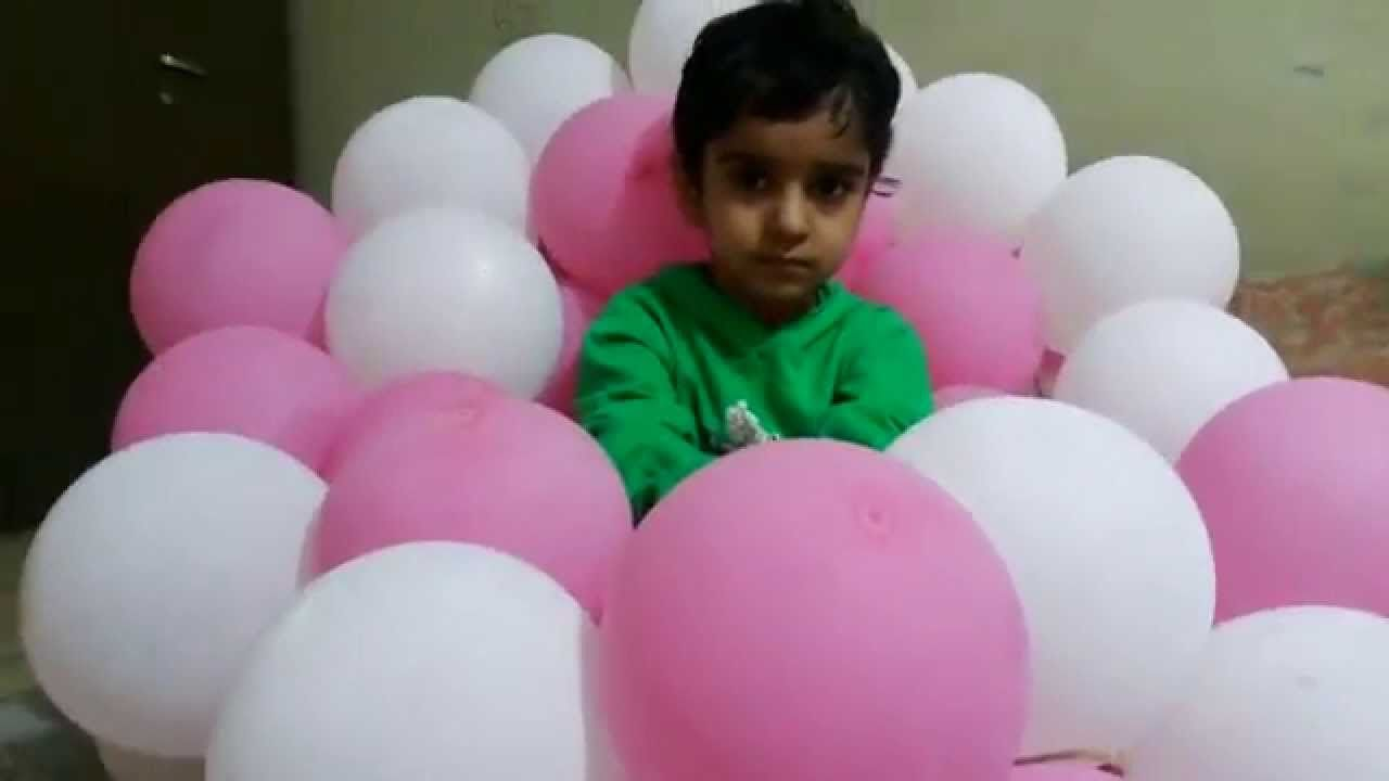 Kids playing in a room of balloons - Activities for Children: Balloon Games