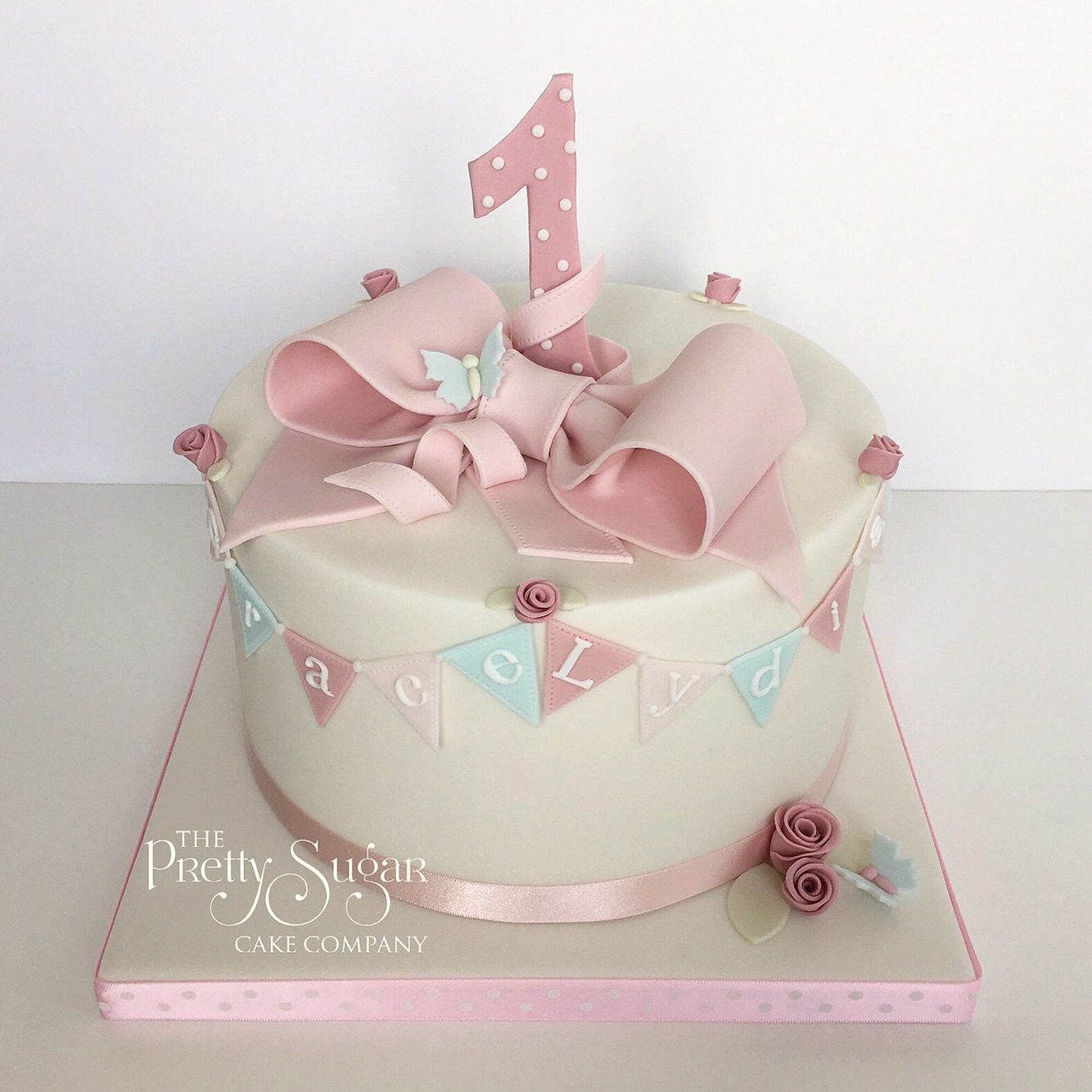 Pastels First Birthday Cake With Bunting And Sugar Bow Detail