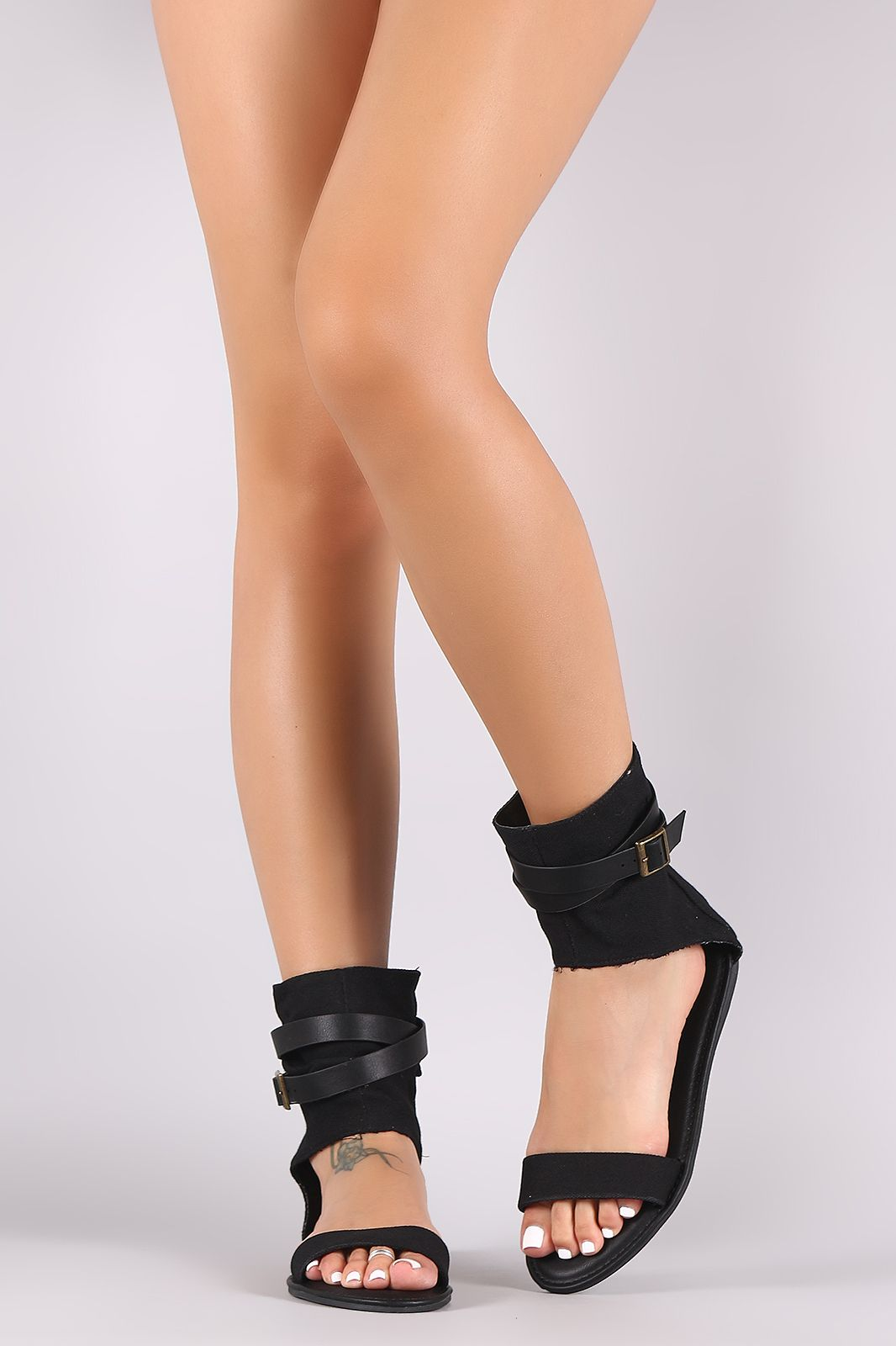 Shop This edgy flat sandal features a