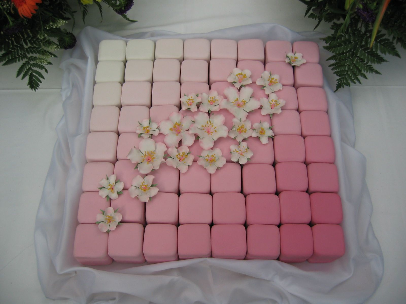 Graduated pink individual wedding cakes