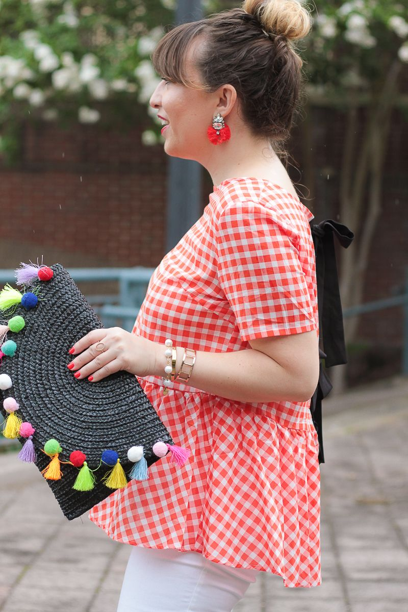 Red gingham top and pom pom clutch