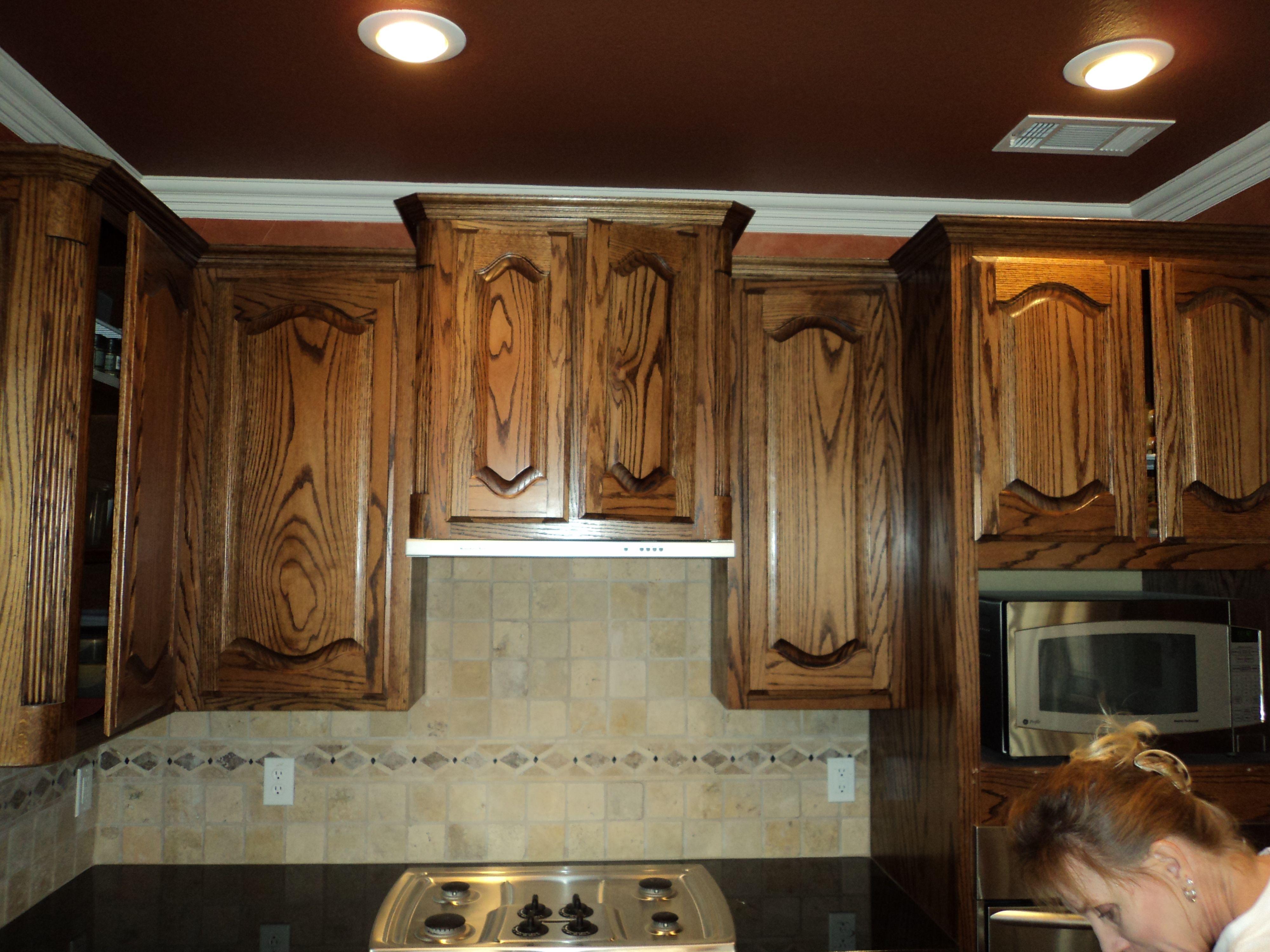 Dark Stained Oak Cabinets In An