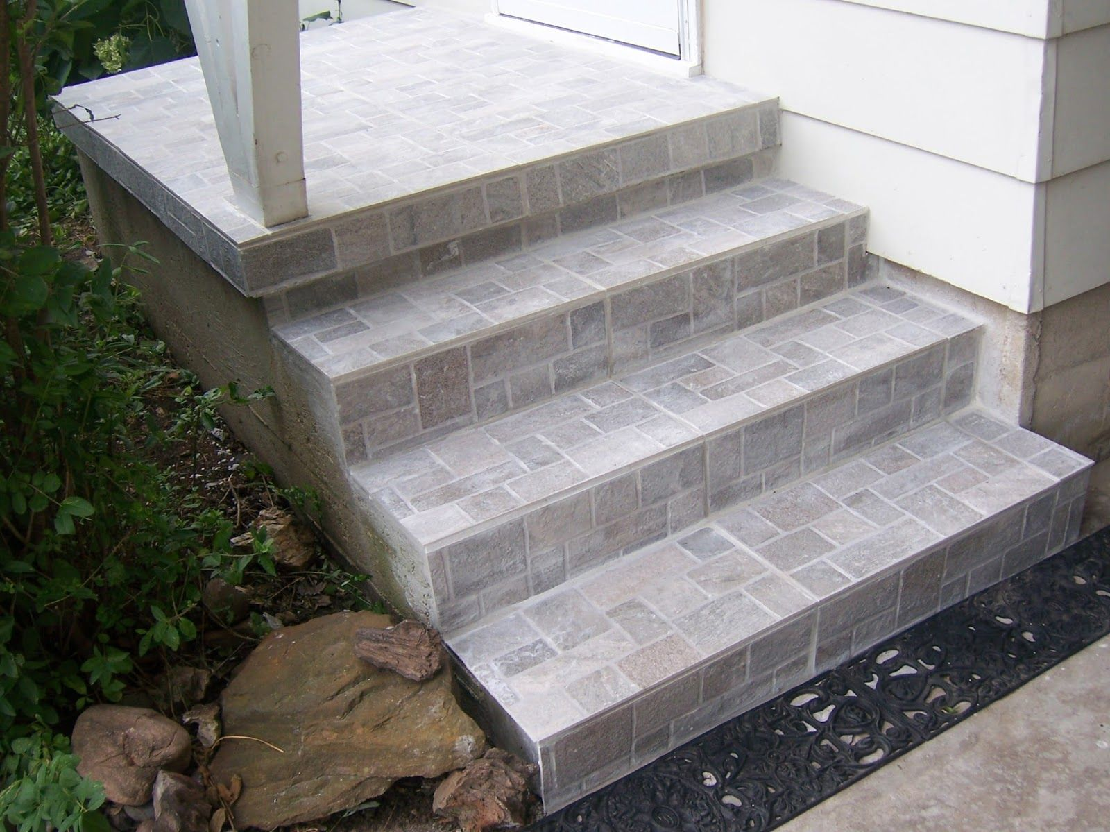 Professionally installed porcelain tile covers old concrete steps ...