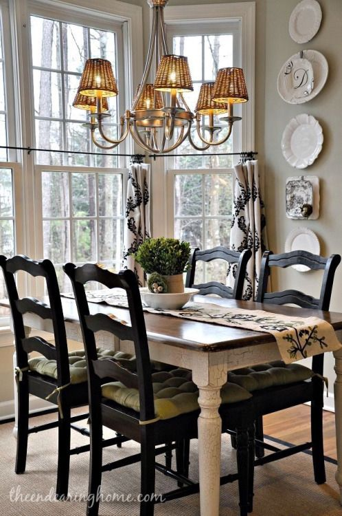 nice dining space .. love the dark chairs with lighter farmhouse ...
