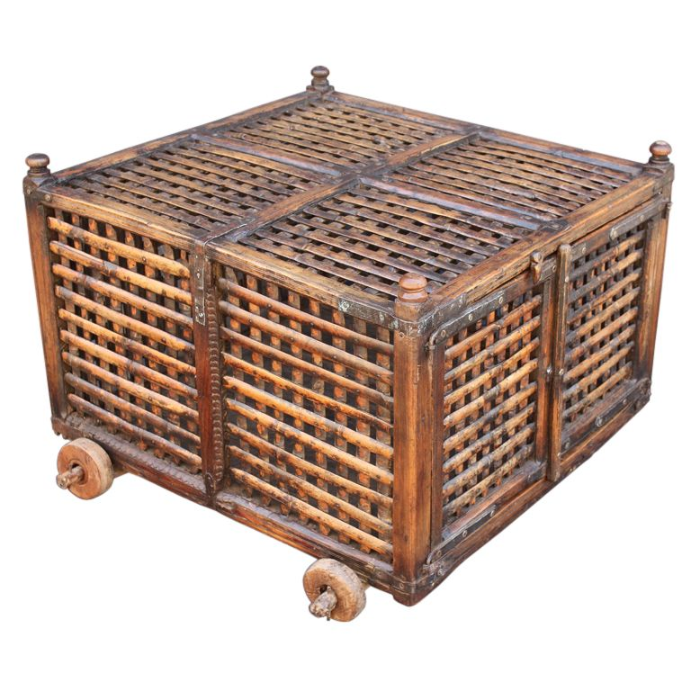Rolling Cart or Market Cage from British Colonial India, 19th c. A handsomely-crafted rolling cart or market cage of wood and bamboo with iron hardware from British Colonial India (The Raj), featuring a cross-hatched slatted top and sides in an iron-bound joined frame with two doors and a latch on the front-facing side, set upon four wooden wheels.