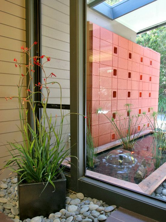 Modern house designs exterior and interior accents for Mid century modern water feature