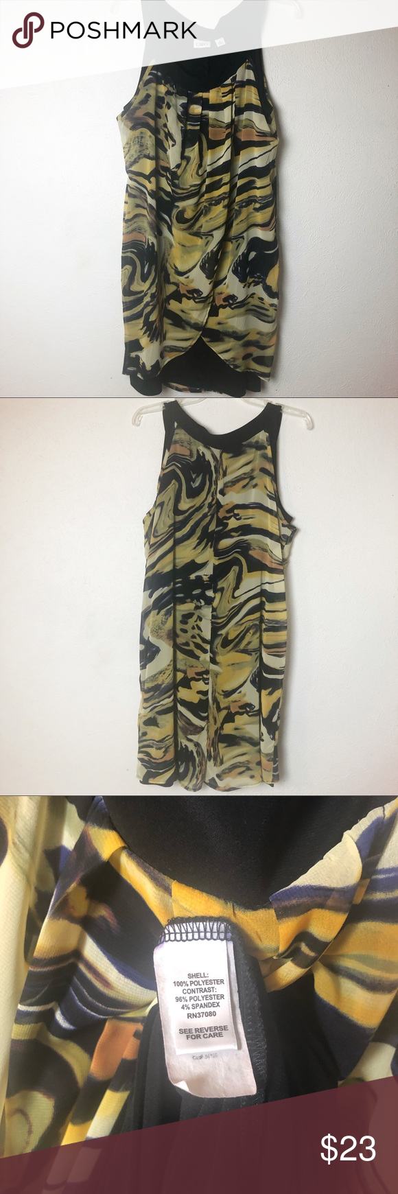 "Cato Layered Sleeveless Dress Size XL Women's Size X. Two layer sleeveless dress. Bottom layer is black. Top layer is a black, tan and gold print that wraps in the front.  Minor thread flaw on right side near seam on last picture.   Approximate Measurements: pit to pit: 21.5"" Length:  38"" Hem: 24"" Cato Dresses Midi #blacksleevelessdress"