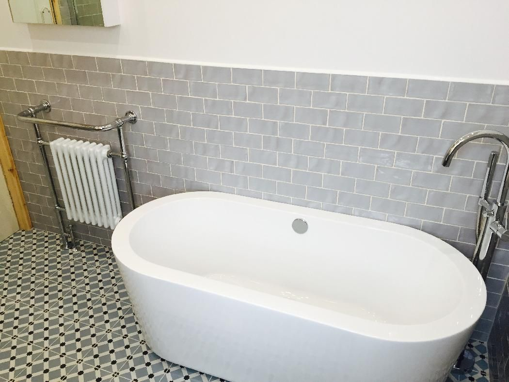The Arc freestanding bath looks amazing in contrast to the grey ...