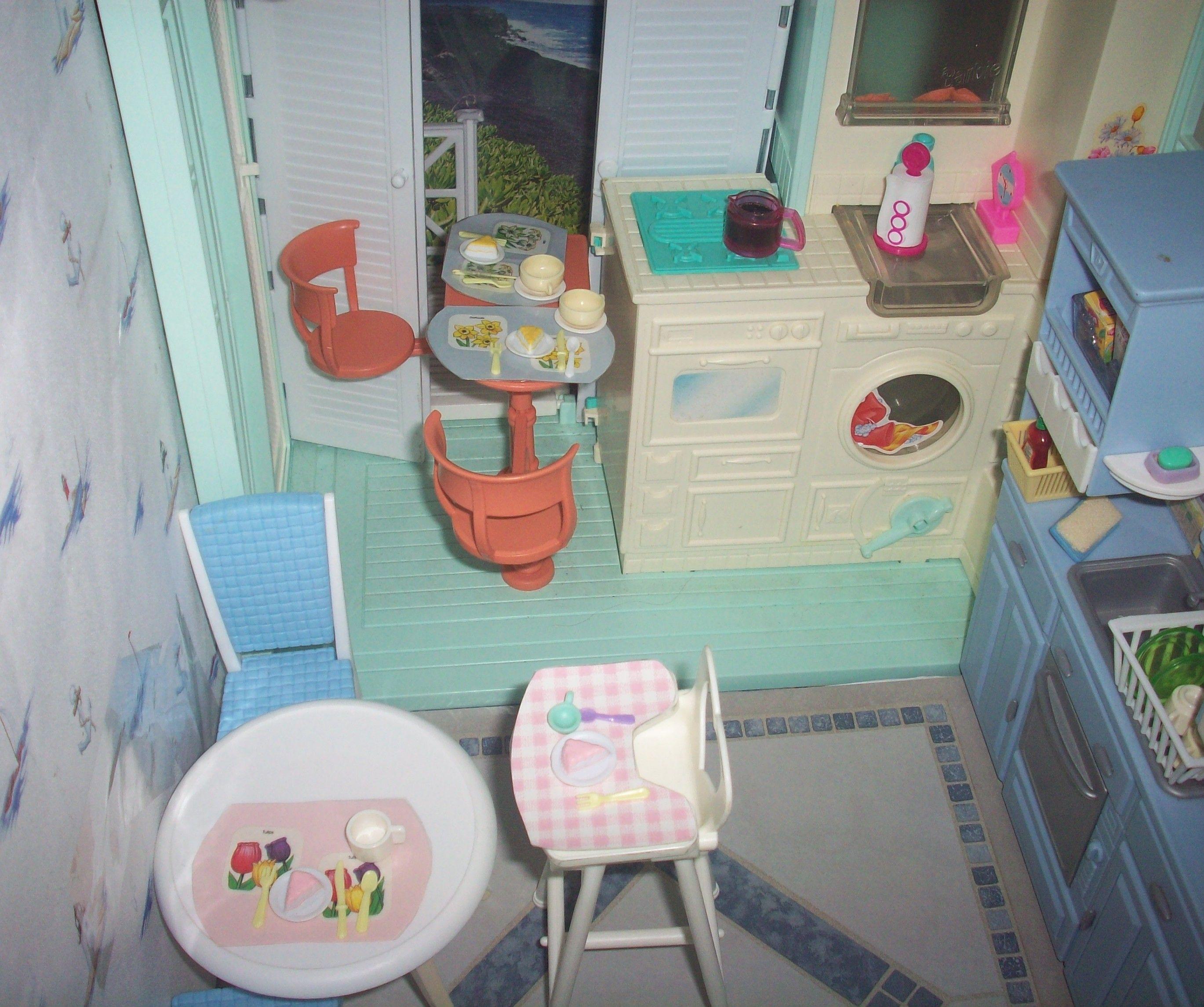 An OOAK beach house kitchen using parts from a Barbie beach house ...