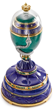 Fabergé - AN 18K GOLD, LAPIS LAZULI, ROCK CRYSTAL AND ENAMEL EGG-FORM ANNULAR EIGHT-DAY DESK TIMEPIECE WITH DIAMOND AND EMERALD SET SERPENT