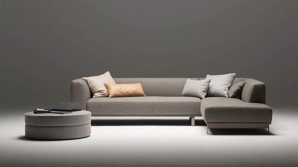 Modernes 3 Sitzer Ecksofa In Dunkelgrauer Stoffausfuhrung Und Dem Dazu Passenden Hocker Von Sitzfeldt Alles Beste Qualitat D Designer Couch Sofa Design Sofa