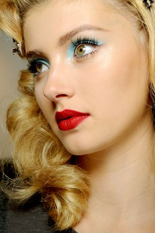 Red lips and blue eye makeup