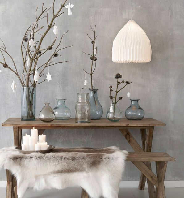 Scandinavian inspiration for the dining room. Grey/white palette with furs and candles to complement.