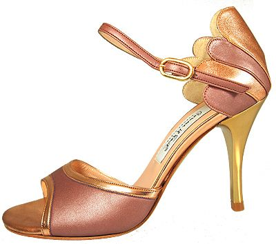 Some yummy gold and bronze sandals with a scalloped heel