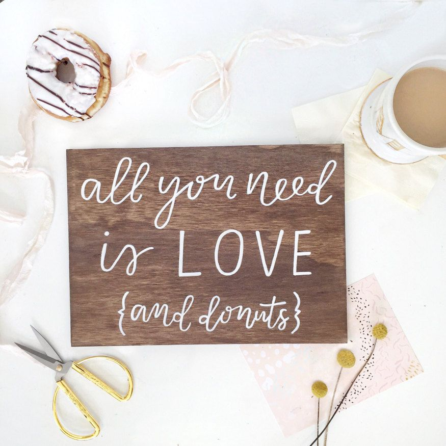 All you need is love and donuts sign wedding cake