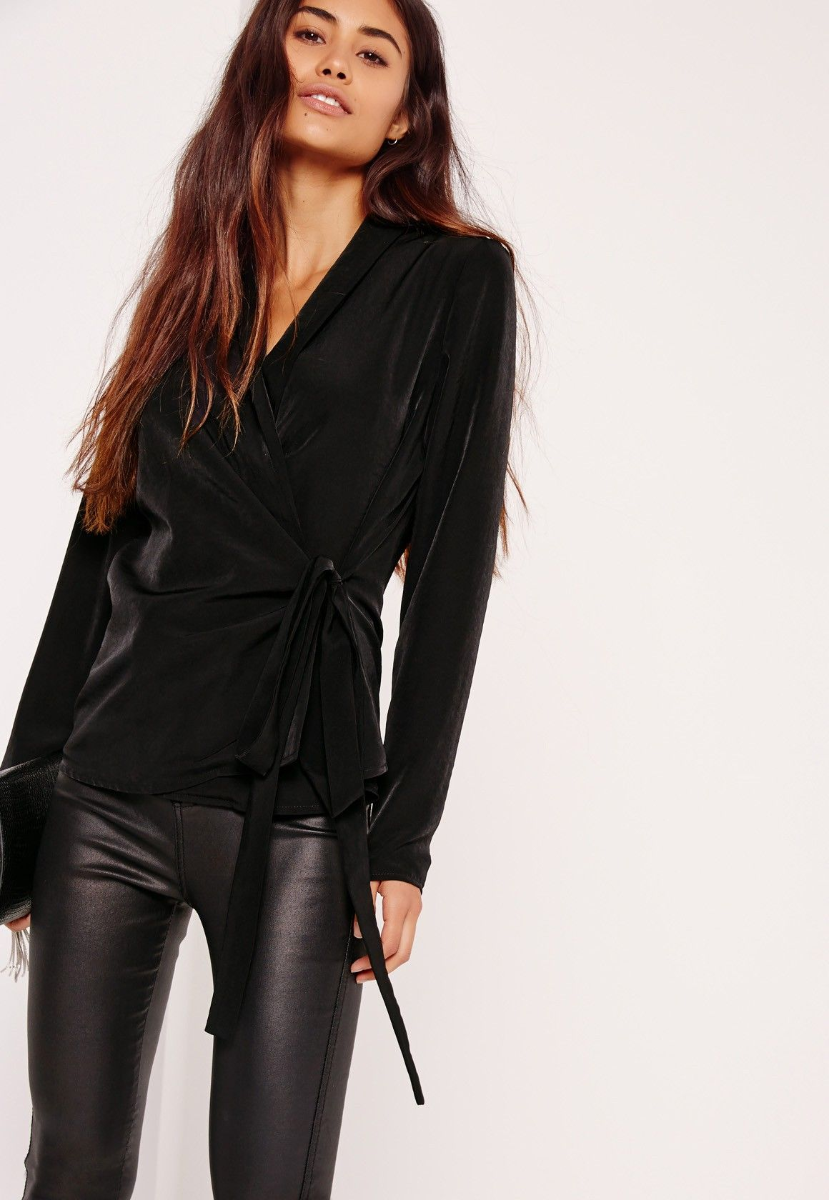 Black never goes out of style and this tie side blouse with a wrap style is…