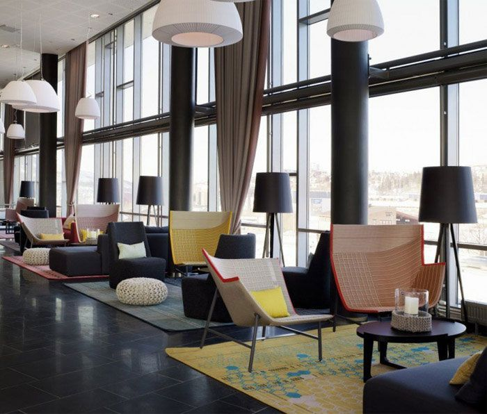 Modern and colourful hotel hotel lobby design for Hotel decor trends