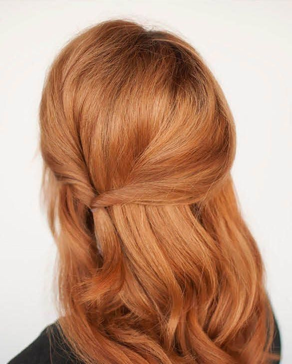Strawberry blonde hair mixes the light of blonde with the