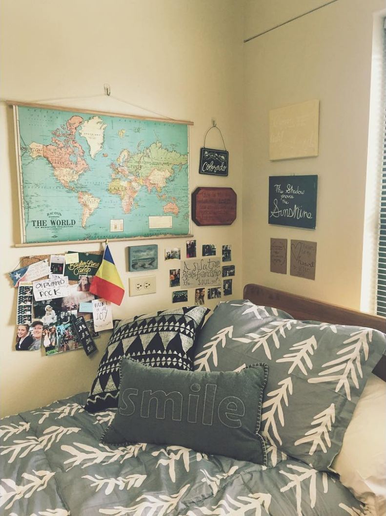 Travel-themed grey and white Baylor University dorm room.  Girls