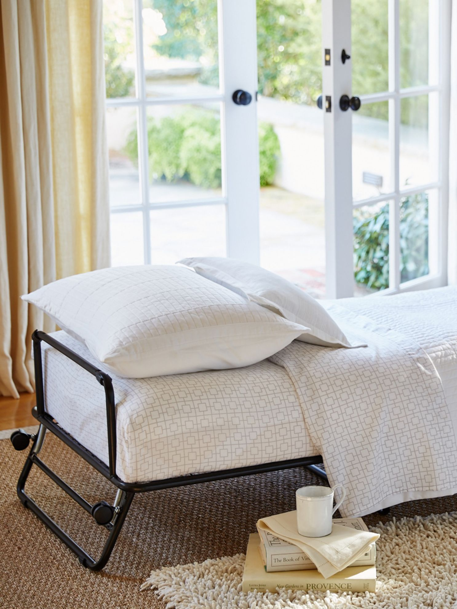 Fold Out Ottoman Bed Hide Your Guests In Plain Sight With The