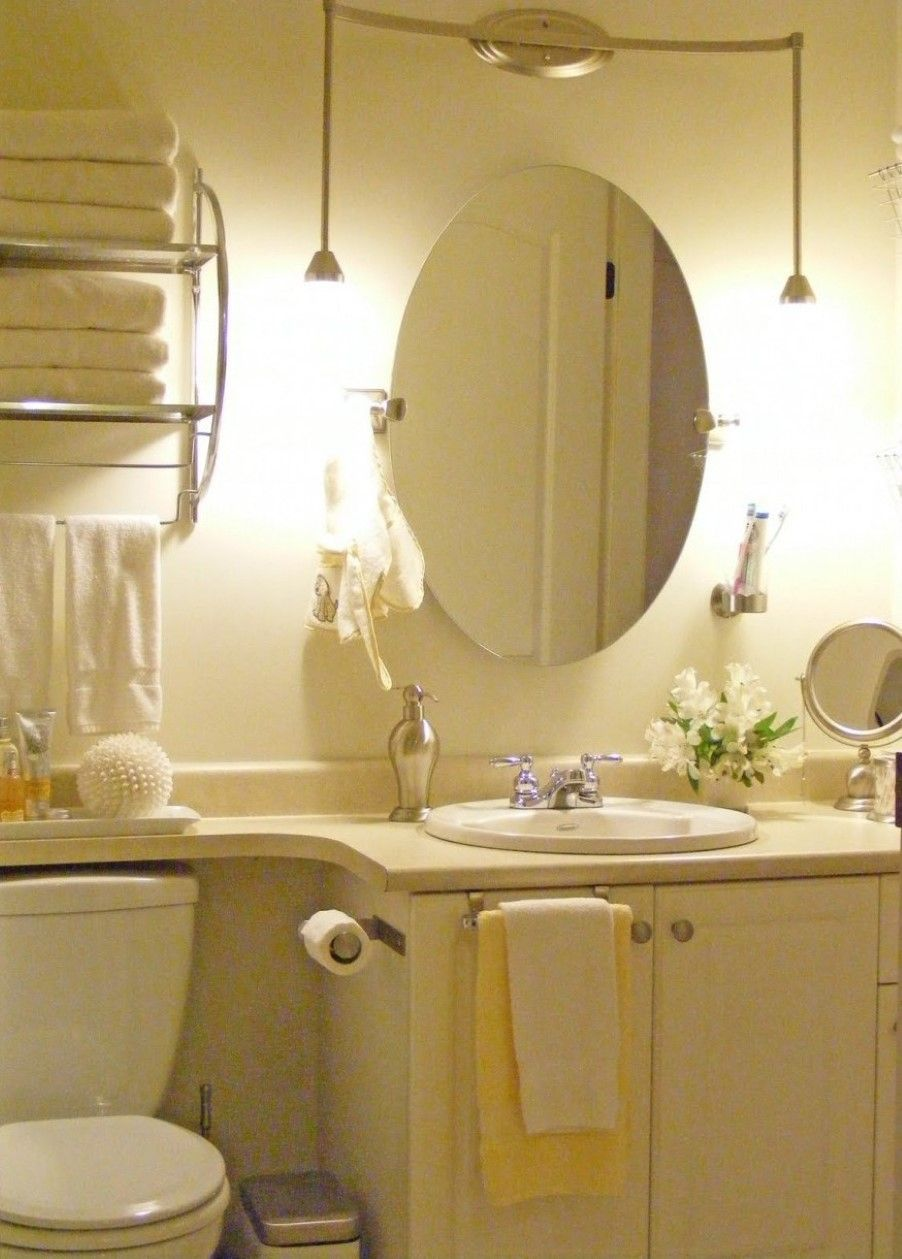 oval wall mirror between pleasing white pendant lighting paired with ...