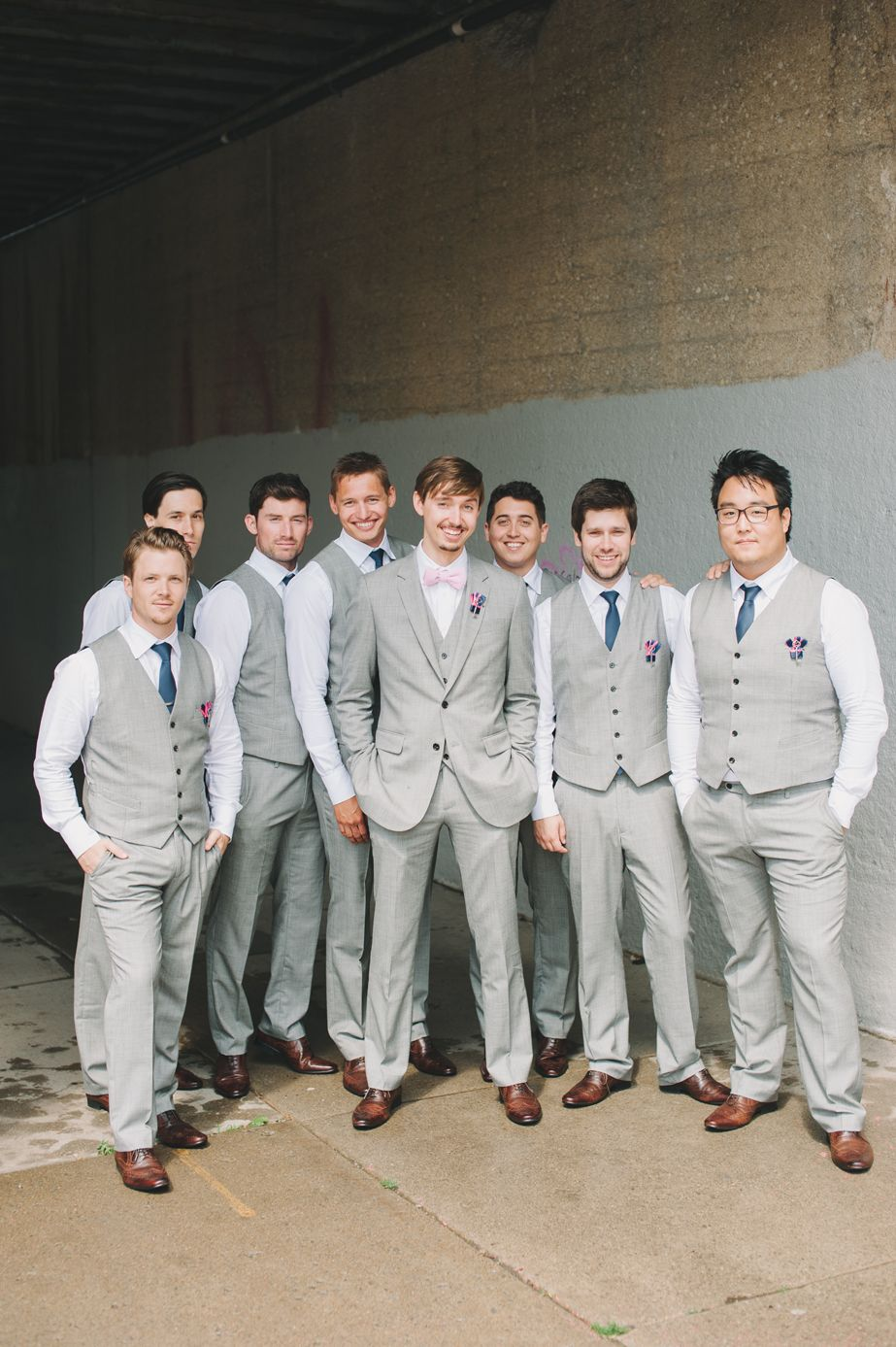 2f60a2866a92 All were in custom made suits from Indochino. The groomsmen had a two piece  suit with a navy tie, and the groom had a three piece suit with a pink ...