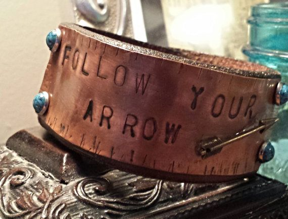 Follow your arrow https://www.etsy.com/listing/182277285/follow-your-arrow-copper-and-leather