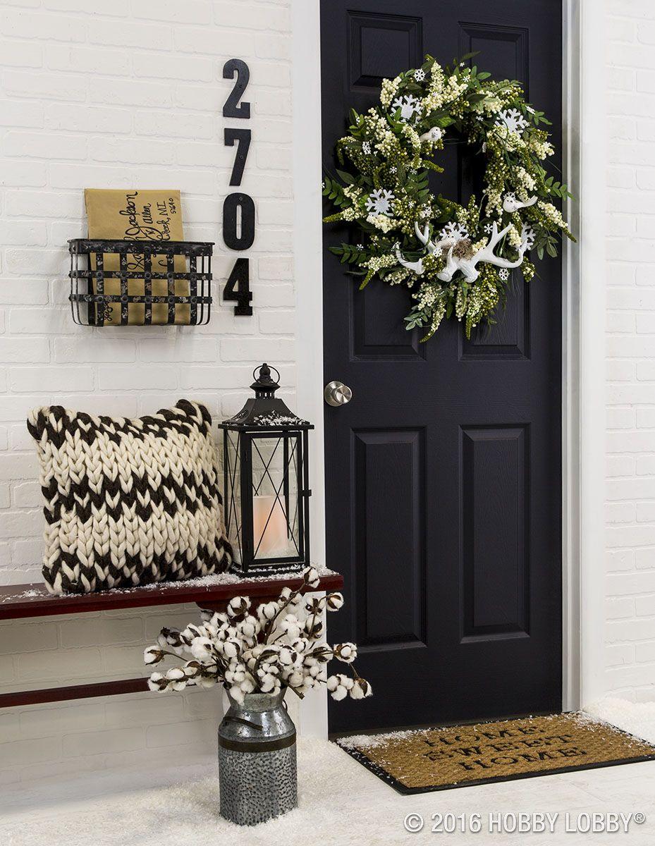 Incorporate front door decor that provides a