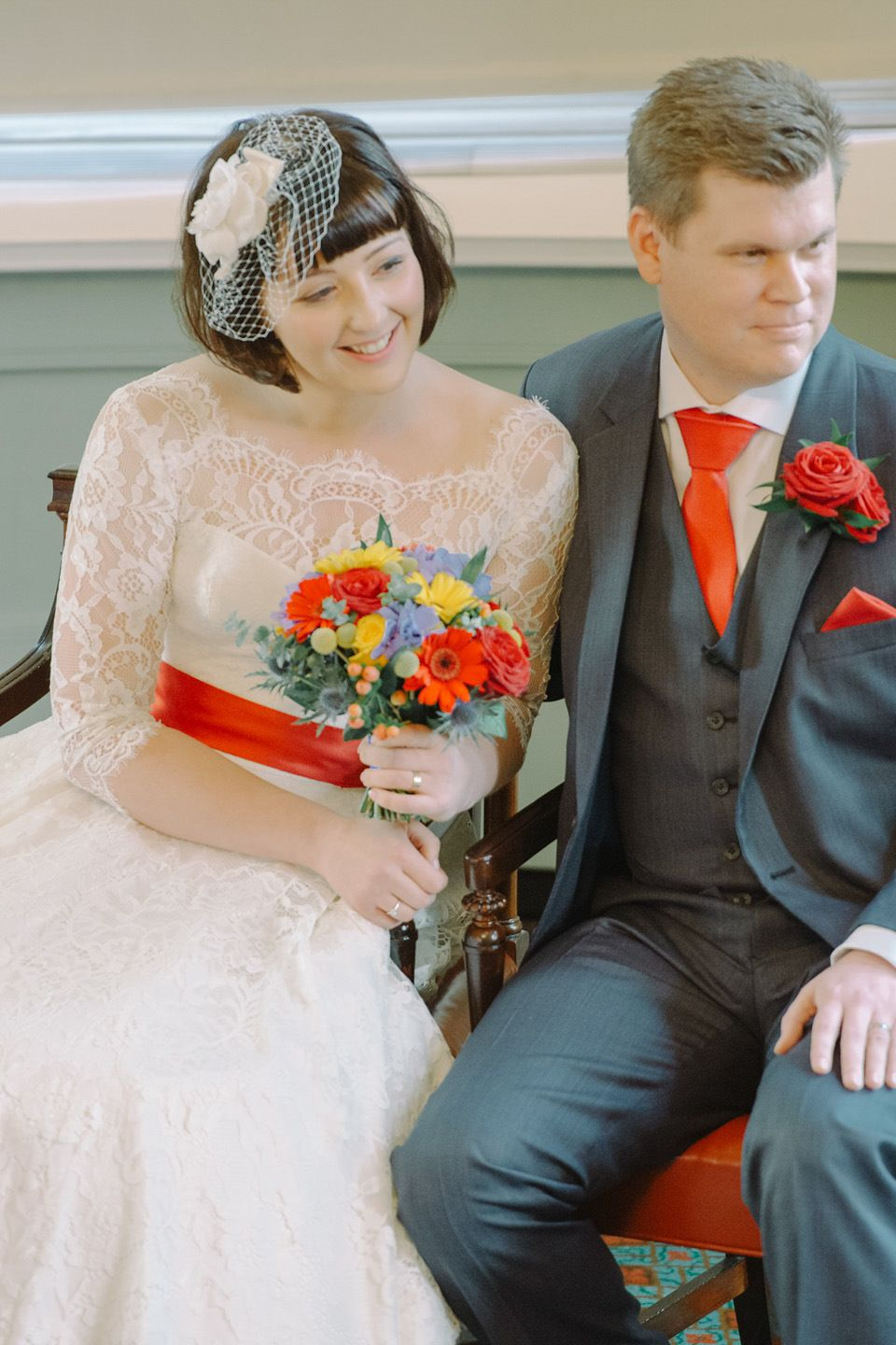 A vintage lego wedding with vibrant colours and tealength lace