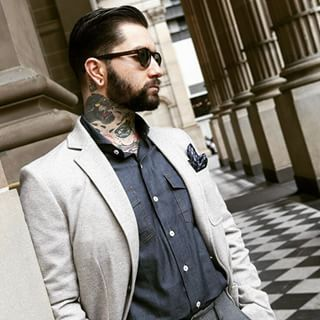 Smart suit and neck tattoos.
