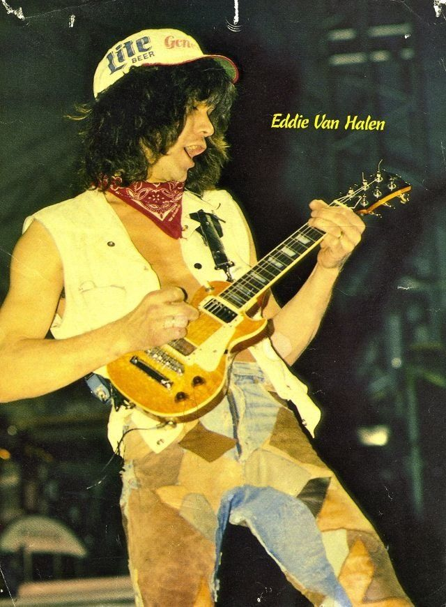 """Eddie Van Halen performs """"Little Guitars"""" at Madison Square Garden in New York City on 31 March 1984. He's wearing a painter's hat with the logo of the short-lived New Jersey-based United States Football League franchise, the Generals."""