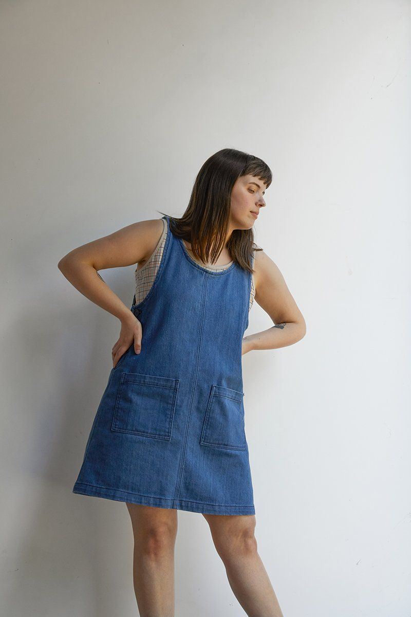 What can we say about the Caroline, she's just so great! The Caroline denim jumper dress is a season-less wardrobe staple that can easily be layered with your favorite top. Featuring front patch pockets and buttons down the side, with a hint of stretch for all day comfort. Made of soft stone washed, pre-shrunk denim. 97% cotton / 3% spandex. This fabric has a little stretch and is meant to have a slightly relaxed fit. Machine wash cold, tumble dry medium. Please note: the Caroline Jumper in Deni
