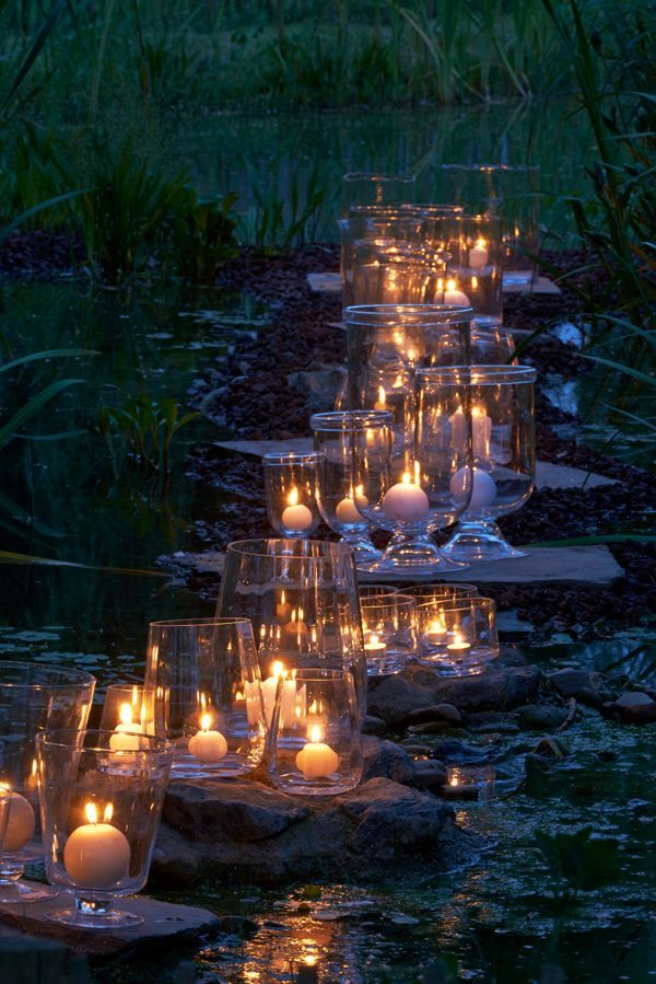 Beautiful candle light flickers softly on the stepping stones across the water! & Beautiful candle light flickers softly on the stepping stones across ...
