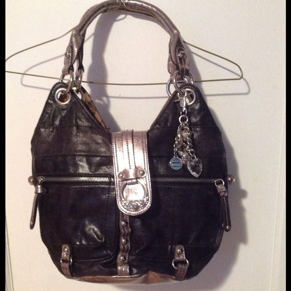 Kathy Van Zeeland purse / handbag  Kathy van zeeland purse it has a zippered compartment in the middle and two other compartments. A zippered pocket on the back..a smaller zipper pocket on the inside..it's black and silver with animal print on the inside .. Very cute.. Distressed black color..smoke free great condition Kathy Van Zeeland Bags