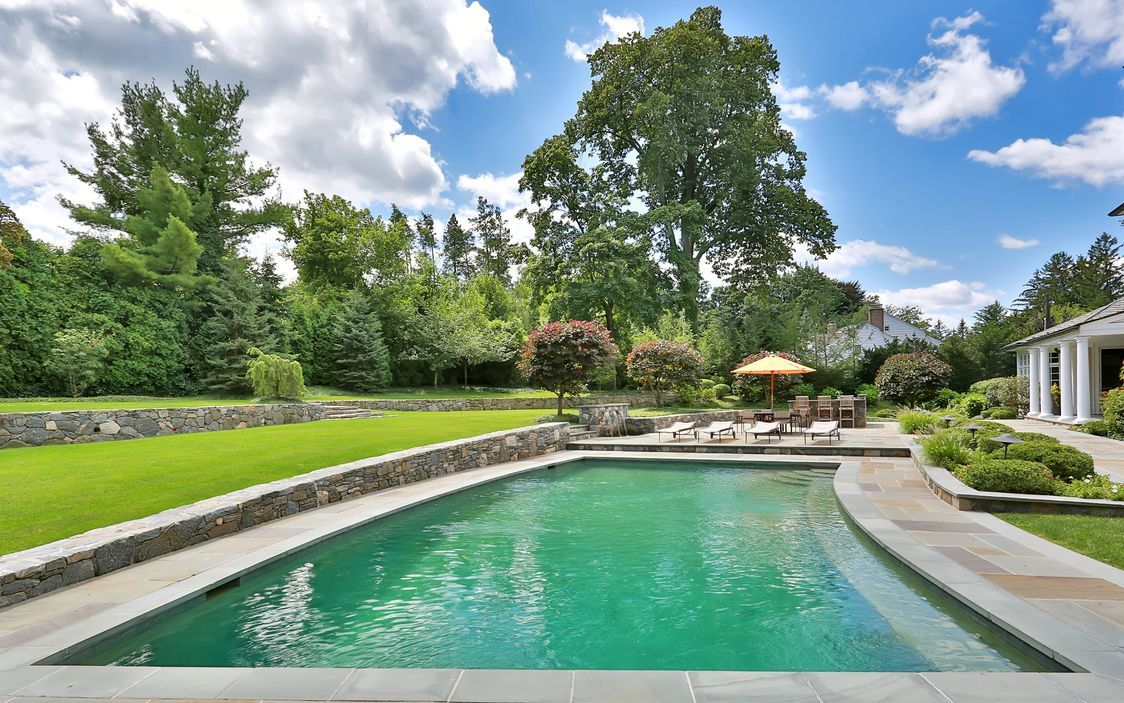 Set on 1.32 acres of private and beautifully landscaped property featuring a stunning 20 x 40 gunite salt-water heated pool